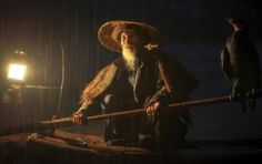 From: www.paulweeksphotos.com  The coolest guy I met in China was this old cormorant fisherman who lived in Xingping. He let me photograph his morning routine which included waking up his annoyed cormorant friends.  #china #photography #world #photos #fisherman #beauty #portrait #art #friendly #culture #light #morning #rain #dark #birds #happy #places #international #travel #paulweeksphotos