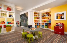 A lovely carpet adds class to the space Transform Your Basement Into A Fun And Colorful Kids' Playroom