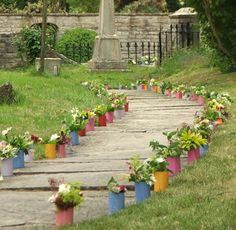Could put jam jar flowers either side of the path down to the barn entrance?