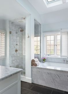 "4: A Contemporary Neutral Master Bathroom in Bethesda, MD The owners wanted their master bathroom to be ""a quiet, soothing space,"" Welch says. She responded with dark slate floors and Carrara marble from Architectural Ceramics."