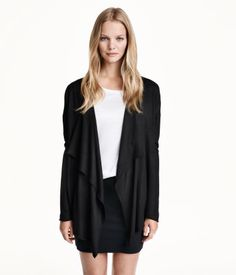 Fine-knit cardigan in a soft fabric with a draped front section. Rolled edges at front and at cuffs. No buttons.