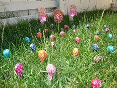 "Your kids plant magical jelly beans, and when they wake up Easter morning, lollipops have ""grown"" where the jelly beans were planted.  Would also be cute to stick in the ground for a hunt on Easter without the magical jelly bean part."