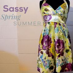 Green floral halter sun dress with bow tie back Super cute dress for the spring or summer! Sass it up with a pearl necklace and a pair of heels. Halter tie top and bow on rear Dresses Midi