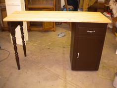 Vintage kitchen cabinet that was made into a kitchen island.  Vintage kitchen legs and added a butcher block top.