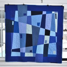 moderndayquilts:    Pretty amazing for a first quilt.    Blue City Quilt by Thomas Knauer, an original design featured on his blog. Also, check out his series on modernism and quilting, the first post is Origin Myths of Modernism.