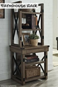 BEAUTIFUL Rustic farmhouse five-shelf audio rack. Made from solid hardwoods in a weathered wood grain finish with aged black hardware, this charming display case showcases an open frame design with X-brace sides and chunky square supports. Display family photos and books along with all of your media accessories. Click the link to get it NOW at Wayfair.com! #farmhousedecor #rustichomedecor #homedecor #roomdecor #livingroomdecor #roomideas #farmhouselivingroom  #ad