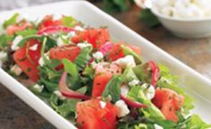 This refreshing salad from BJ's has cubes of cool watermelon, arugula, mixed greens, pickled red onions, feta cheese and mint with honey vinaigrette  - BJs Watermelon Feta Salad