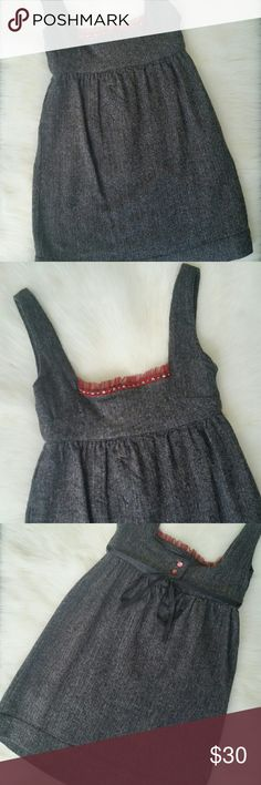 Free People Oktoberfest Tweed Wool Blend Dress Pair this Free People dress with some tights and a cute cardigan for this fall season.   Brown tweed wool blend dress. Small red lace trim in front with embroidered flowers. Ties in back with a black ribbon and has 3 buttons. NO TRADES! Free People Dresses