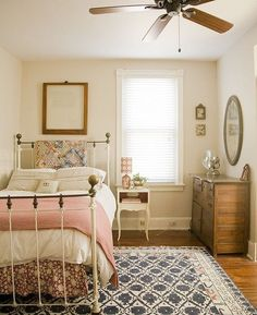 Small room with twin bed, rug, small nightstand, and dresser. Tons of character