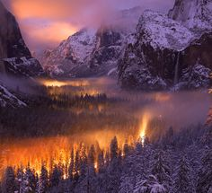 ❧ Yosemite National Park, United States. Yosemite Valley at Dusk: A mist had settled over Yosemite Valley, as automobiles passed through, headlights illuminated the fog.