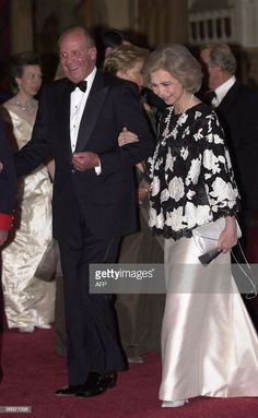 King Juan Carlos and Queen Sofia of Spain making their way into dinner hosted by Britain's Queen Elizabeth II at Windsor Castle Monday June 17 2002