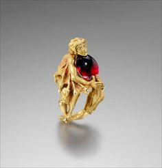 "KEVIN COATES V ""VAMPIRE""  Ring. 20K gold, garnet  44mm high x 27mm wide x 31mm deep"