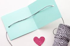 Nothing is greater than a handmade Valentine's day card for that special someone! Today, I created a small and easy Valentine's Day Card for the hubs and my daughter.All you really need is a few materials. You will need: card-stock paper, vinyl, scissors, hole puncher, glue gun, string and…