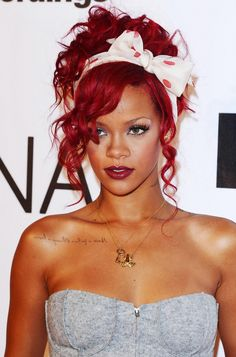 Singer-songwriter Rihanna Fenty looks fabulous with her curly, cherry-red hair in a playful up'do. Description from herinterest.com. I searched for this on bing.com/images