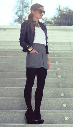 Leather jacket, gray skirt, black tights, white shirt