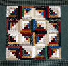 Quilt  Pattern: Log Cabin   I can't play with my imaginary friends for a while—reality's calling. When I'm not a novelist, I'm an editor, an...