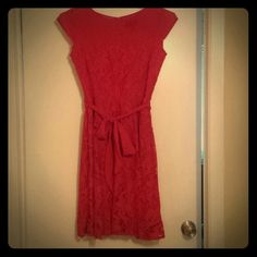 Dress Red, cap sleeve, hem hits just under the knee. Sash that ties in the front. Back zipper and attachment at the neck to help keep it closed. Tags still on, never been worn outside of store. Dress Barn Dresses Midi
