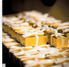 Elegant gold truffle boxes tied with a simple ribbon.  http://www.nashvillewraps.com/candy-boxes/truffle-boxes/c-048906.html