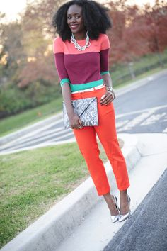 Nifesimi wearing a bright striped sweater and orange pants (love the metallic accessories) (from Skinny Hipster)