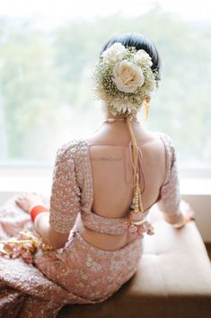 Bride wearing a floral bouquet bun with a pink lehenga. Braided Bun Hairstyles, Wedding Hairstyles, Bun With Curls, Bridal Hair Buns, Pink Lehenga, Floral Hair, Floral Bouquets, Bridal Looks, Wedding Inspiration