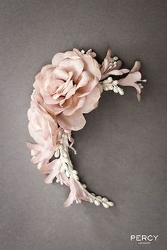 Handmade floral hairpiece for a modern bride.