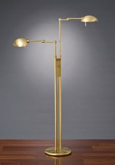 "Halogen Floor Lamp No. 2505/2. The twin-light floor lamp, 2505/2, is the perfect solution for two light sources in one lamp. Both arms are independently adjustable and dimmable. Vertical adjustment of each arm from 40"" to 57"" with a maximum extension of 20"". Two turn-knob dimmers in easy reach adjust 100 Watt halogen bulbs by Osram in each arm."