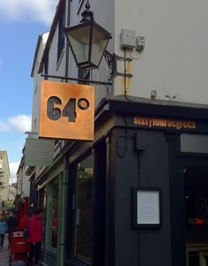 copper sign | 64 Degrees restaurant | designed by Niche I.D. in Brighton