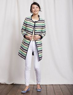 Cover up in style with this statement coat. The straight, collarless shape looks sleek worn over fitted dresses, or adds a smart touch to laid-back weekend dressing. A multi-stripe pattern gives it a fun finish that will have you standing out from the crowd.