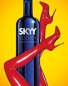 SKYY VODKA. You're drawn to the ad because of its bold colors. They use these three basic colors (which appeal to men and women) - red, blue, and yellow. The ad uses a woman's body, more specifically her legs to sell alcohol/their product.