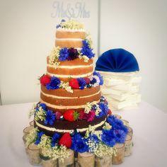 Wedding cake , naked cake ombre sponges chocolate caramel lemon and white vanilla . Fresh edible flowers and fresh fruit Sommerlich