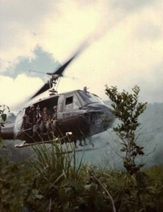 "A squad from ""A"" Company, 1st Mechanized Battalion, 50th Infantry lifts off in a Huey helicopter during a mission in the Binh Thuan Province, Vietnam, 1970."