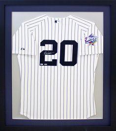 Custom baseball jersey signed by Jorge Posada of the New York Yankees. Designed and framed at Art & Frame Express in Edison NJ.