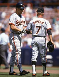 Former Baltimore Orioles great Cal Ripken Jr., left, gets coached by his dad Cal Ripken Sr. during a 1992 game. Ripken Jr. played his entire 20-year MLB career with the Orioles a feat rarely done in modern baseball.