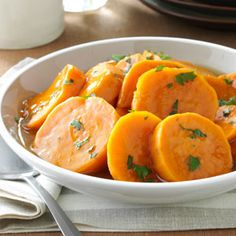 Potluck Candied Sweet Potatoes Recipe -To make it easier to bring this traditional Southern staple to a potluck or gathering, I updated it so that it can be cooked in a slow cooker. It's hard to go wrong with candied sweet potatoes when it comes to pleasing a crowd.—Deirdre Dee Cox, Kansas City, Missouri