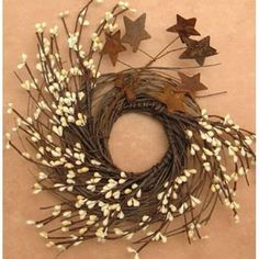 CWI Gifts Pip and Twig with Rusty Star Wreath, 10-Inch, Ivory CWI Gifts http://www.amazon.com/dp/B004DLH410/ref=cm_sw_r_pi_dp_ZpvFub0XQN5CX
