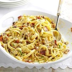Fettuccine Carbonara - When a man at church found out how much my family likes fettuccine carbonara, he shared his Italian grandmother's recipe with us. I've made it my own over the last 25 years. Grated Parmesan cheese works just as well as Romano. Cooked frozen peas are also a nice addition