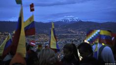 "From BBC News: ""Employees of the Venezuelan embassy in El Alto, Bolivia, hold Venezuelan and Bolivian national flags during an Andean ritual for the health of Venezuelan President Hugo Chavez. Chavez says he is recovering well, in his first comments after undergoing an operation in Cuba."""