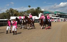 """A caravan of jockeys, horsemen, ponies and friends of Dr. Rosalyn Randall, the track's late Association Veterinarian, begin the 1-mile """"Walk for Roz"""" to benefit the Susan G. Komen for the Cure fight against breast cancer. About 100 people walked once around the main track!"""