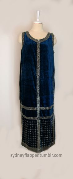 """Blue velvet gown with silver lined bugle beads, early 1920s. The dress is labelled """"Rue de la Paix Gowns"""", an export house that sold copies of high-end couture pieces to professional buyers from international shops."""