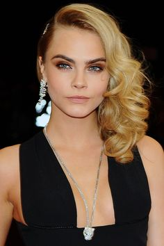 Make a statement with your look a la Cara Delevingne by curling your hair and sweeping it dramatically to one side. A smoky eye may be intense, but absolutely perfect for a bride-to-be with a big evening planned.