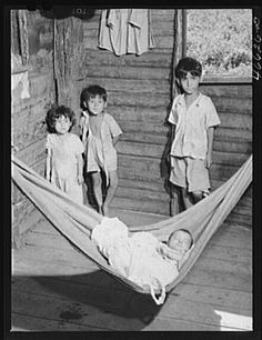 Manati, Puerto Rico (vicinity). Children of a farm laborer in their house which is on land FSA (Farm Security Administration) is buying for a tenant purchase project