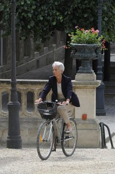 Christine Lagarde rides a bike