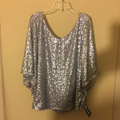 Blouse In time for the holidays- Sequin top with butterfly sleeves...neckline is a V in front and back - Polyester - size14 Xscape Tops Blouses