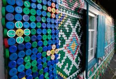 in the russian village of kamarchaga, in the siberian taiga, russian olga kostina has used 30,000 plastic bottle caps to adorn   her home with colorful patterns and images - making it somewhat of a local landmark. over many years, kostina collected the lids and once she felt there was enough she created detailed   murals across the walls of her home with images of traditional macrame motifs and various creatures living in the neighboring woodland.