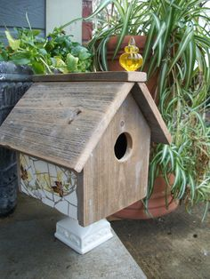 partially mosaic-ed birdhouse