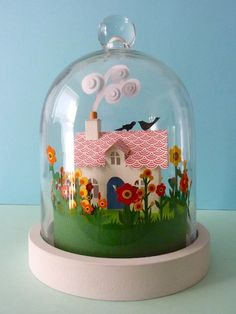 paper cottage under a cloche