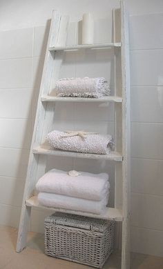 What a clever way to repurpose an old ladder that may be missing a rung, not quite level, not tall enough... whatever! I'd love to see this painted hot pink in a girl's room with books or stuffed animals on it and hooks for jewelry or tote bags/purses on the side... Such a lot of potential in a small footprint!