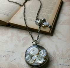 Vintage Pocket Watch filled with Mother-of-Pearl buttons.   What else could you put in it?