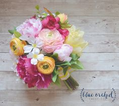 This spring wedding bouquet is full of peonies! Pink and Yellow Bouquet with…