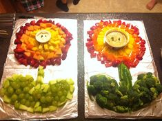 Fire power Mario party fruit tray with green grapes, strawberries, cantaloupe, and pineapple
